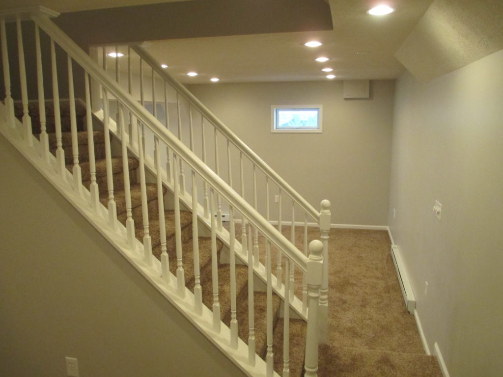 Basement Finishing recessed lighting dimmer stairs baluster painting handrail carpet molding trim