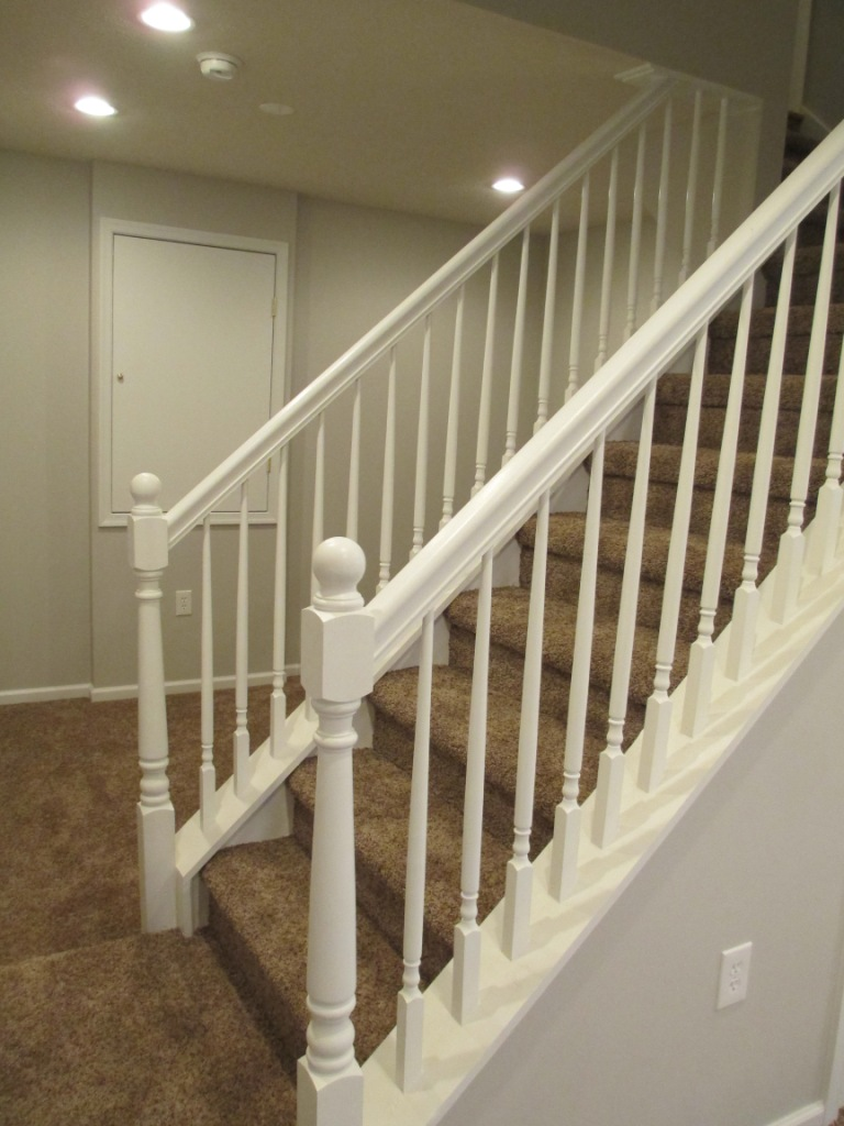 Basement Finishing stairs railing balusters newel post baseboard door casing electrical wall framing drywall electrical switches dimmers recessed lighting electric heat